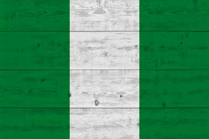 Nigeria flag painted on old wood plank. Patriotic background. National flag of Nigeria