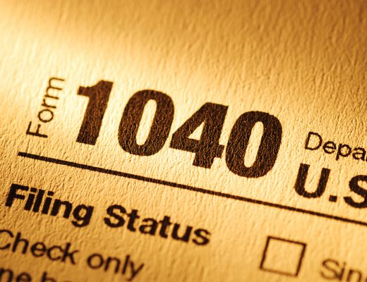 Form 1040 for declaration of Personal or individual Income Tax to the American IRS or Treasury in close up in yellow light